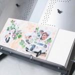 процесс сборки свадебной фотокниги на станке